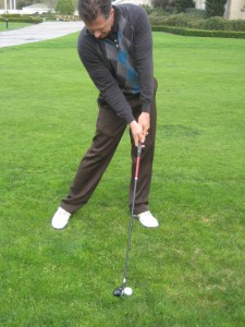 Bill McKinney showing proper Golf Downswing Body Position before impact