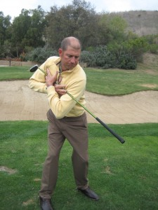 Marc Minier showing how to use core golf pivot in the golf back swing