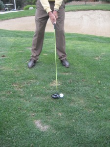 golf ball position inside left heel