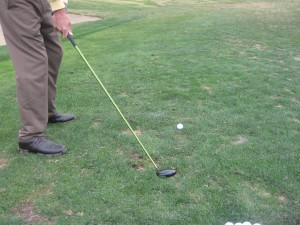 aiming left, cutting across the ball and hitting a golf slice