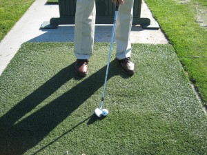 golf ball in middle of stance for an iron