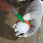 Marking your golf ball using a plastic ring from a Gatorade bottle cap