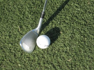 where to aim on the golf ball at impact